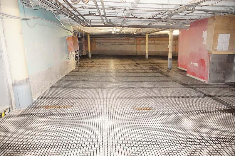 Carbonbeton brachte bei der Instandsetzung des Parkhauses gleich mehrere Vorteile mit sich: Die Bewehrung benötigt nur eine geringe Betonüberdeckung und sie korrodiert nicht. Foto: solidian